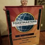 esquire-toastmasters-banner-and-mary-harlan